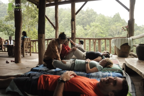 Locals massage at Tree House Village after the days trek